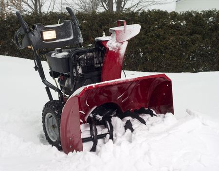 snow blower in the snow in winter Stock Photo
