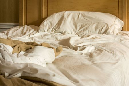 unmade: unmade bed in hotel room