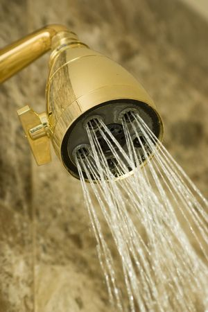 water flowing from golden colored shower head