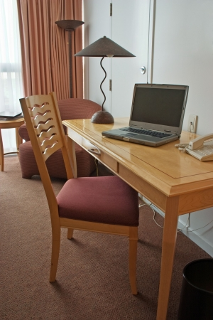 work desk with laptop in hotel room Stock Photo - 3627524