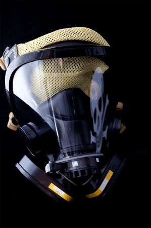 gas mask with skull and cross bones reflected in face shield