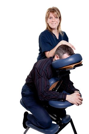 clothed: man getting a therapeutic chair massage from a female therapist