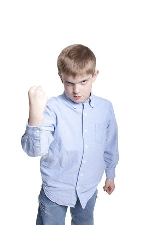 angry blonde: Young boy shaking his fist in anger Stock Photo