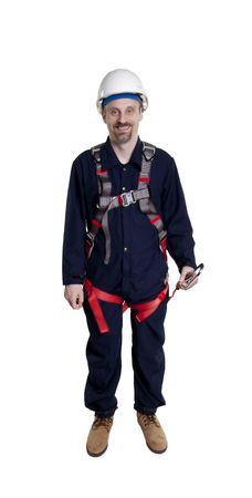 Man wearing fall protection harness and lanyard