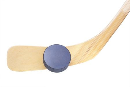 close up of an ice hockey stick and puck isolated on white background