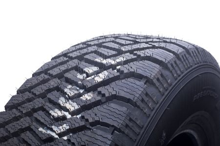 close up of winter tire tread on white background