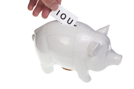 hand dropping IOU note in piggy bank - dept