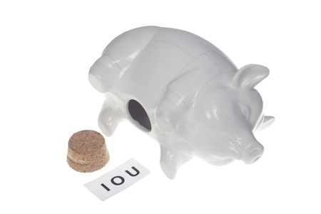 Empty piggy bank with IOU sign inside - dept