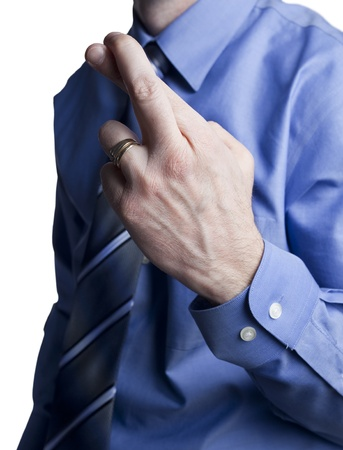 business man in a blue shirt and tie with crossed fingers for good luck