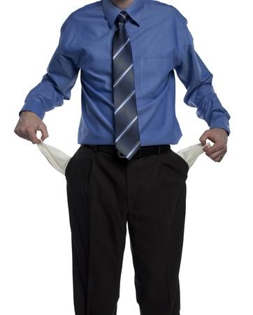 bolsa dinero: hombre de negocios con sus bolsillos vacíos, demostrando que no tiene dinero