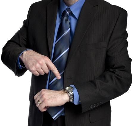 上司は彼の時計を示唆しているあなたは仕事に遅刻を指してください。
