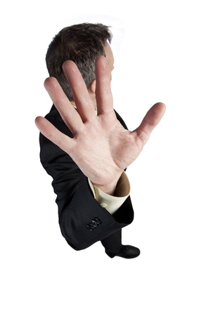 Man holding out his hand and turning his head to avoid getting photographed