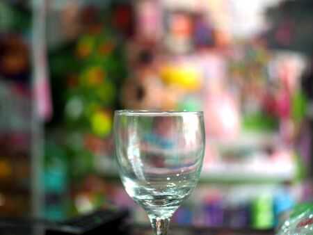 Empty glass on the background bokeh color variety