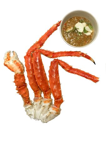 Alaskan king Crab and Seafood sauce on a white background. Stockfoto