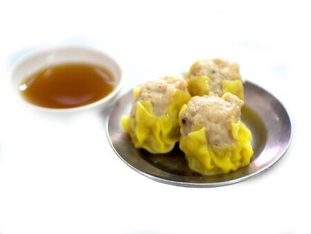 Shumai steamed yellow on a white background