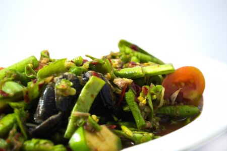 Spicy green bean put crabs fermented fish on a white background.