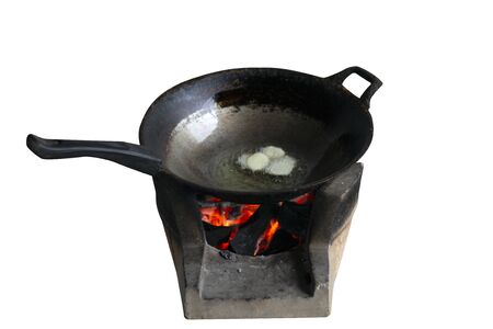 Old pan on  brazier on the white blackground,with clipping path Stock Photo