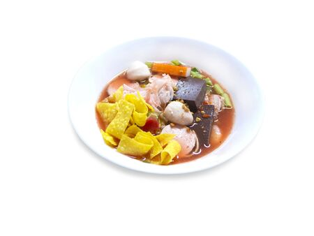 Noodles with seafood soup and red on a white background,with clipping path