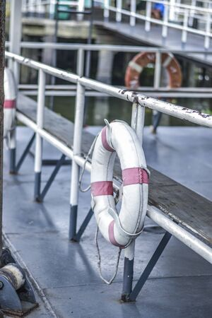 Life buoy in the tourist boats. Stock Photo