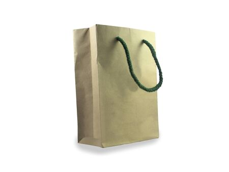 Brown paper bag on a white background Bags made from paper. Biodegradable plastic is much faster. For reuse to minimize waste by plasma fell dramatically