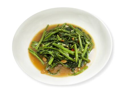 Stir Fry Water Spinach or  Stir-Fried Swamp Cabbage with Salted Soya Bean on a white background Stock fotó