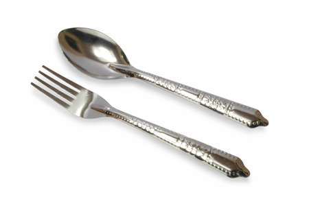 Stainless steel cutlery on a white background
