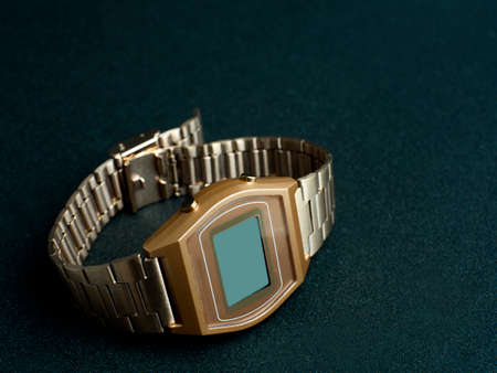 Gold watch on the background With black surface
