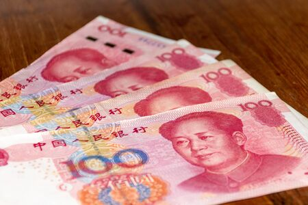 The Currency of China - Renminbi or RMB or Yuan notes spread out on the table. Money exchange.