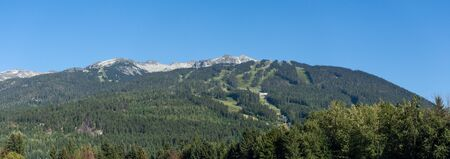 Whistler Mountain Panorama in British Columbia, Canada in the summer sun and blue sky looking at sky lift and runs used for mountain biking and hiking. Reklamní fotografie