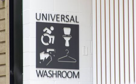 Universal bathroom or washroom sign in a public park in Canada. A controversial topic surrounding transgender rights and issues.