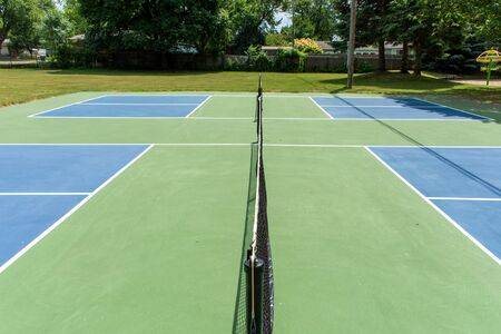 Recreational sport of pickleball court in Michigan, USA looking at an empty blue and green new court at a outdoor park. Middle Court View. Reklamní fotografie