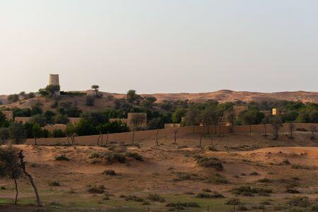 """Ras al Khaimah, Ras al Khaimah/United Arab Emirates - 12/2/2019: ""Ritz Carlton Desert Hotel Resort in Ras al Khaimah United Arab Emirates at sunset looking at the sand dunes. Luxury Travel."""