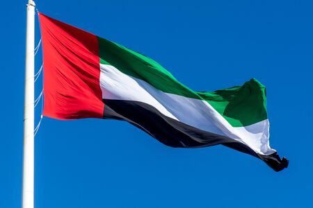 United Arab Emirate Flag flying and waving in the sunshine with a in preparation for national and flag day.