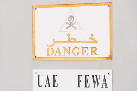 United Arab Emirates FEWA Danger sign for industrial electrical warning in English and Arabic.