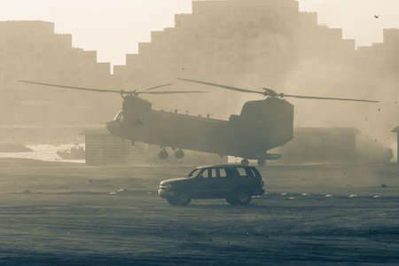 Chinook military chopper takes off in combat and war flying into the smoke and chaos and destruction. Military concept of power, force, strength, air raid. Stock fotó