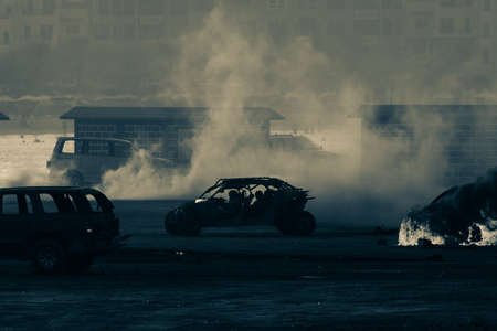 Military strike on a car sets it on fire after a riot in war. Smoke and flames fill the air. Military concept. War, strength, explosion.