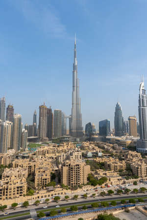 8/11/2020 - Dubai, United Arab Emirates: Iconic portrait shot of Burj Khalifa and Dubai Skyline during the day with and other skyscrapers in the Middle East with blue sky