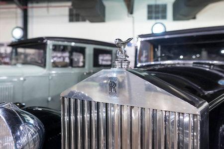 """""""7/31/2021 - Sharjah, UAE: Rolls Royce Logo on black car close up a luxury classic United Kingdom brand"""""""