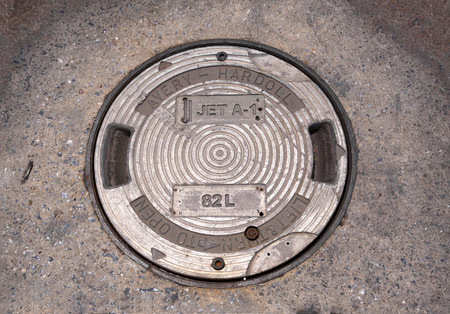 unhygienic: Sewer grate on a city street Stock Photo