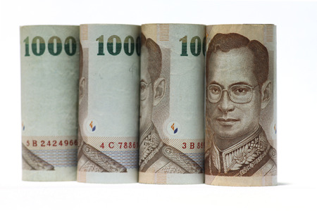 commercial activity: One thousand baht Thailand banknote with white background.