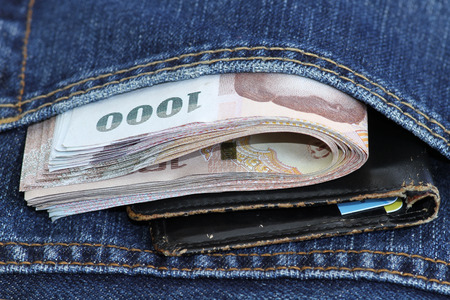bank note: Thailand bank note and pocket money in jeans pocket.