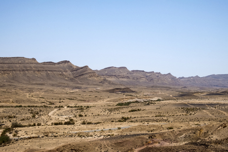 The landscape of Colored Sands with a few desert plants below (Israel)
