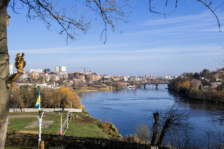 Southern Bug river in the late autumn and the view of the bridge connecting the old and new city (Ukraine, Vinnitsa)