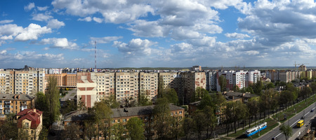 White clouds float above the city. Panoramic cityscape. Roofs of houses are trembling under the weight of clouds (Ukraine, Vinnitsa, Pirogov street) 版權商用圖片