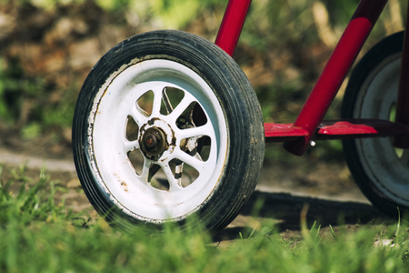 Rear wheel of tricycle. Part of the childrens three-wheeled bicycle of the USSR 80s Stock Photo