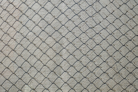 Mesh netting Rabitz casting shadow on polypropylene back tension surface