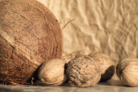 Walnuts and coconut are on the table