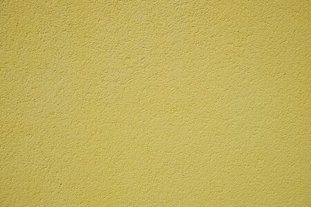 Yellow rough surface of the plastered wall Stockfoto