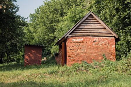 Red brick shed with wooden roof covered with slate