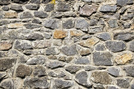 Old stone wall. Granite Wall Surface Stockfoto